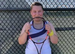 Peyton Culwell, CTHS tennis player and cancer survivor, with her tennis racket